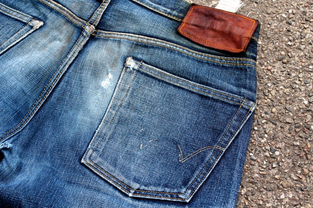 Denim glossary - fading on back pocket
