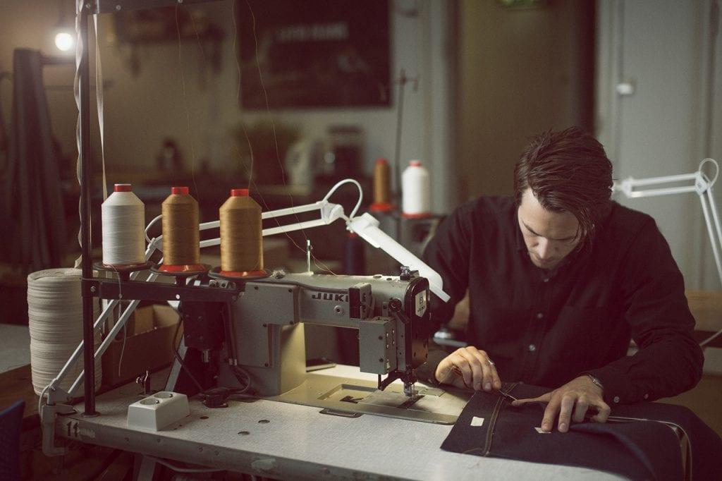 Jens Olav Dankertsen of Livid Jeans sewing jeans