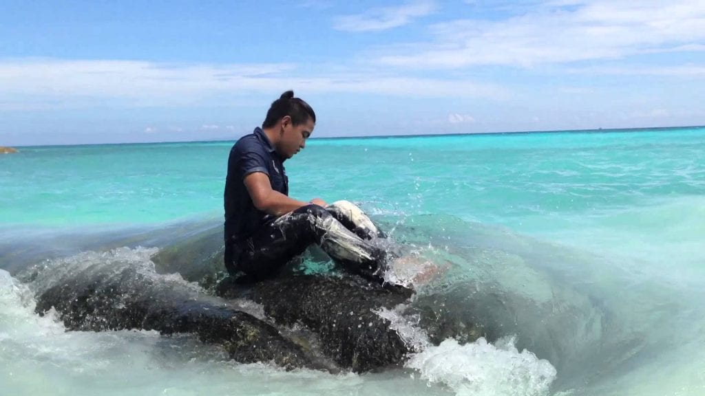 wash jeans in the ocean