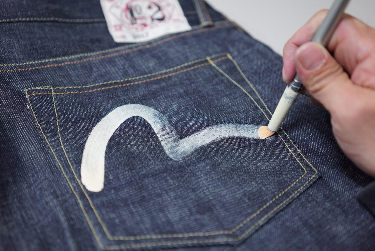 Hand-drawing seagull arcuate on Evisu raw denim jeans